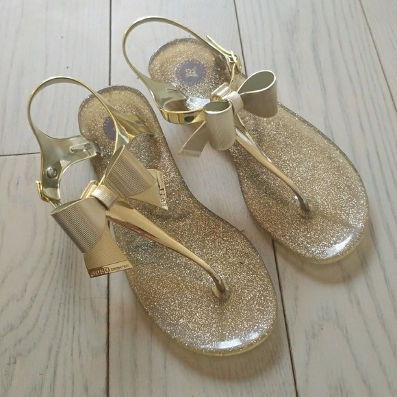 7eb20f5b507a BCBG Shoes - BCBG gold beena jelly sandals